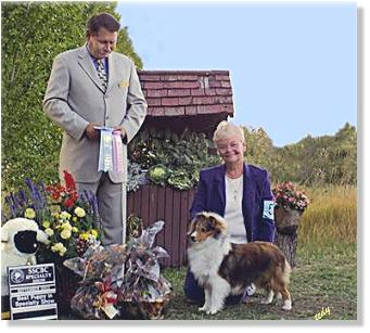 Lexi is pictured at 7 months old winning BEST PUPPY IN SPECIALTY SHOW